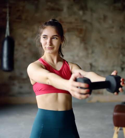 lifting-dumbbells-active-gym-woman-adult-athlete-girl-athletic-muscular-body-beauty-boost-trainer_t20_Bmr6RZ.png